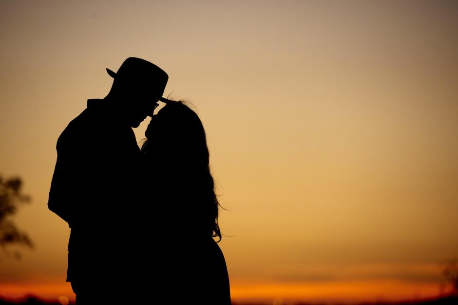 Sunset silhouette engagement photos at VFW park in downtown Georgetown