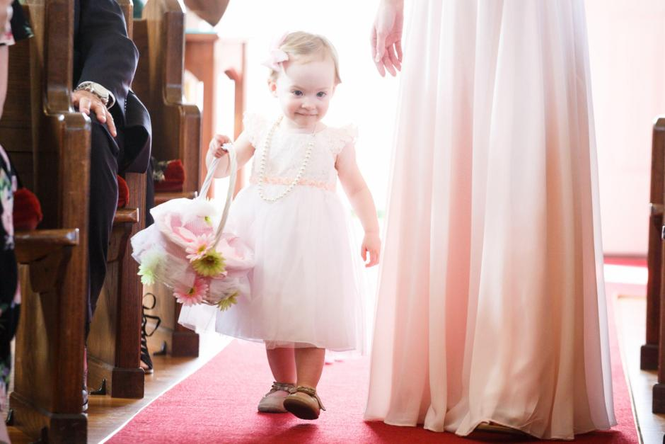 Joshua and Brittany Wedding - A cute flower girl entering Hyde Park Presbyterian Church in Austin, TX.