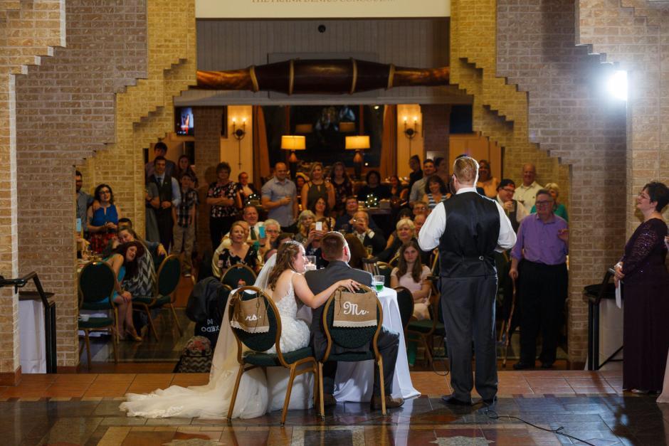 Joshua and Brittany Wedding - Bride reacting to a toast at her UT Alumni Center wedding reception. Etter-Harbin Alumni Center.