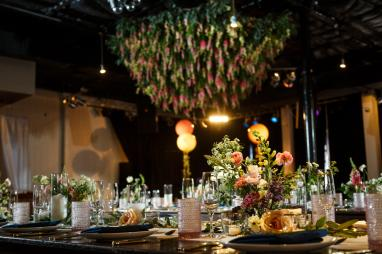 Mike and Kathie's Palm Door on Sixth wedding center pieces backed by huge hanging flower chandelier by Valerie Wolf of David Gray
