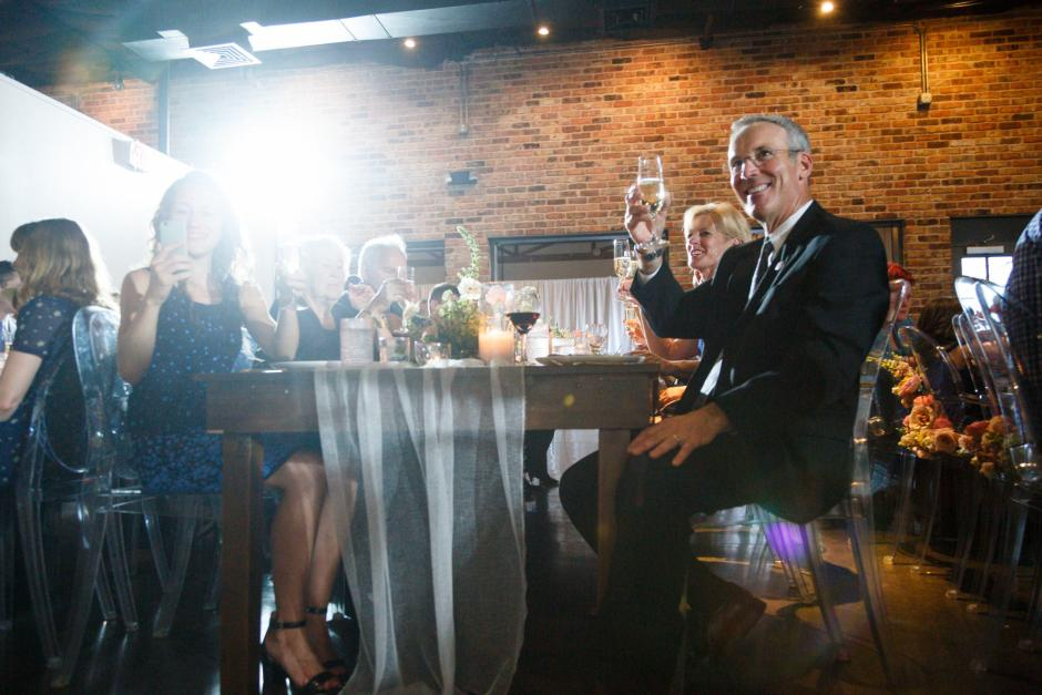 Guests toasting Mike and Kathie during their Downtown Austin Palm Door on Sixth Wedding Reception