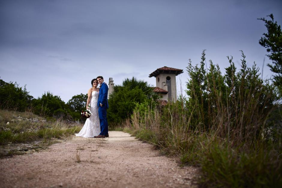 Bride and groom take dramatic wedding portraits at Chapel Dulcinea in Austin.