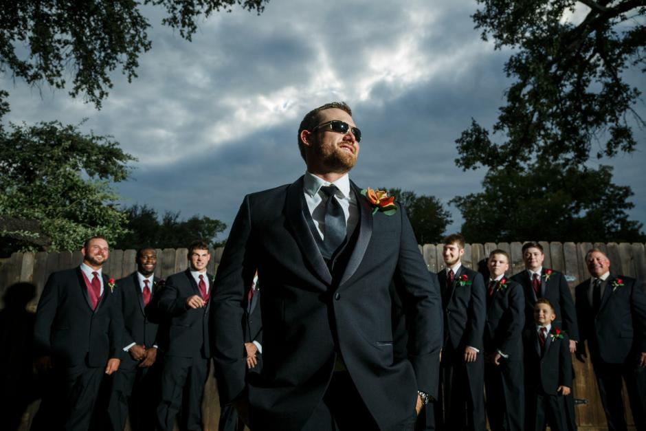 Groom looking epic under stormy skies at Cathedral Oaks in Belton, Tx.