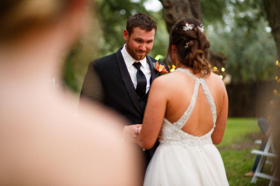 Groom looks at the bride mischievously at a Cathedral Oaks Wedding in Belton, Tx