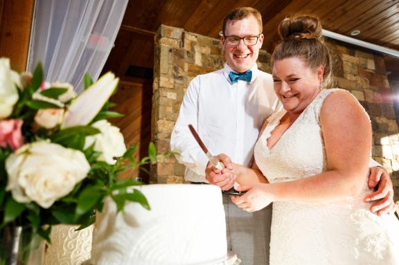 Bride and groom cut their wedding cake at The River Venue in New Braunfels, TX.