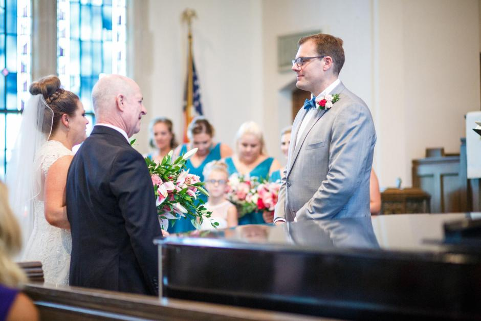 Groom wait for bride at United Methodist Church Wedding in Seguin Texas