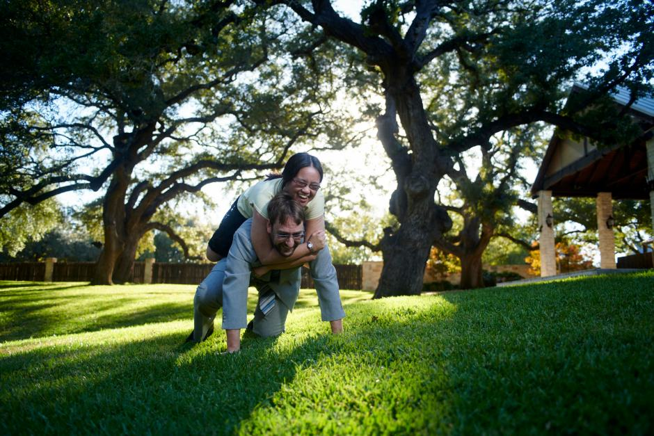 Nicole and James at Cathedral Oaks for their Engagement Photos - Having fun under the large oak trees at sunset.