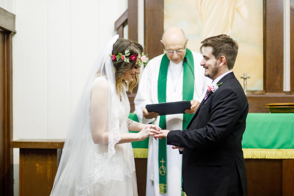 St Johns Lutheran Church Old Fashion Wedding ceremony - Austin and Meagan exchange rings in Denhawken near San Antonio, Tx.