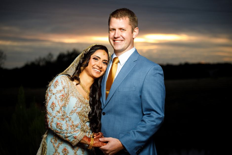 Bride and groom at sunset at a Heart of Texas Ranch Wedding in Marble Falls Texas - Indian-Christian Fusion Wedding