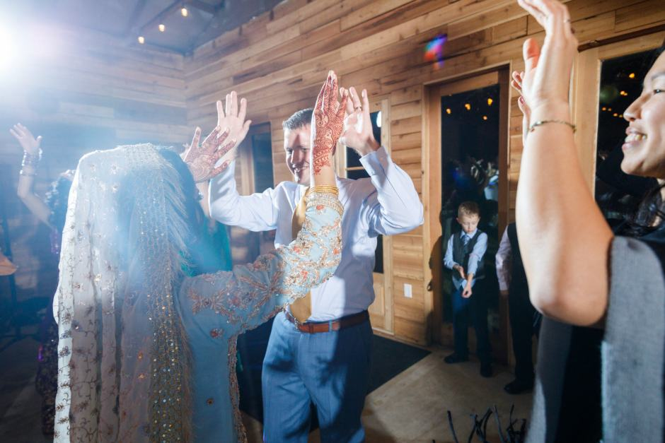 Bride and groom enjoy a dance during their Heart of Texas Ranch Wedding reception in Marble Falls Texas - Indian-Christian Fusion Wedding