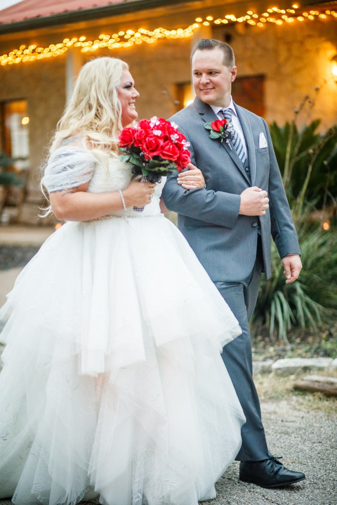 Bride and groom leave their wedding ceremony at Ruby Ranch and Lodge in Buda, Texas new Austin.