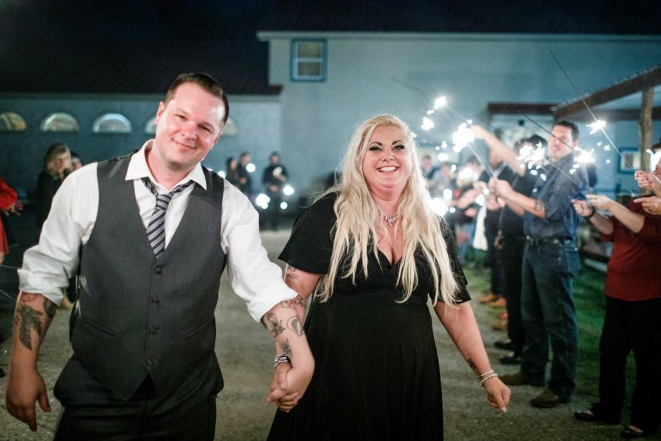 Bride and groom exit their Buda Texas wedding reception with sparklers.