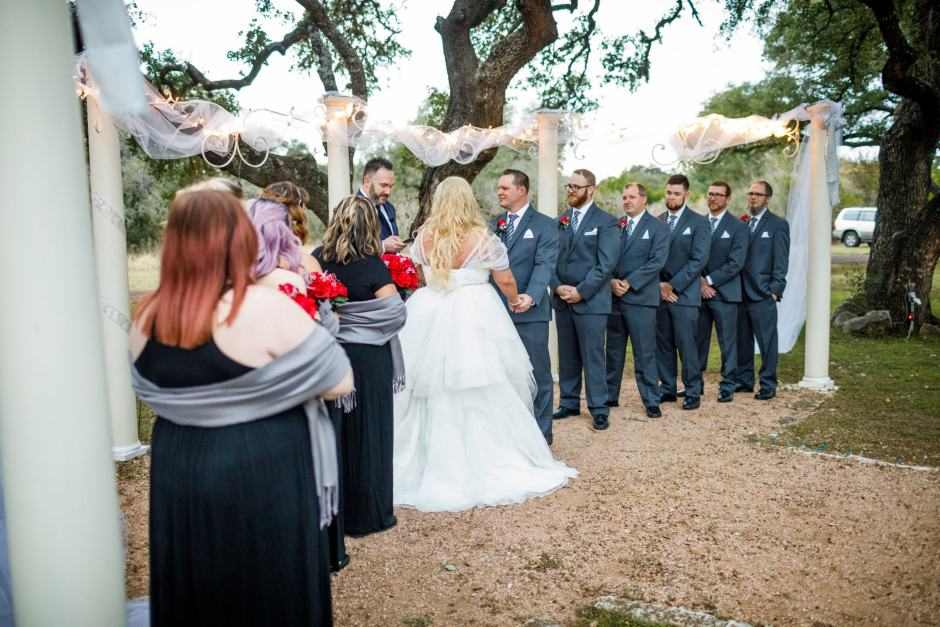 Bride and groom meet at the alter during their Ruby Ranch and Lodge near Austin Texas wedding.