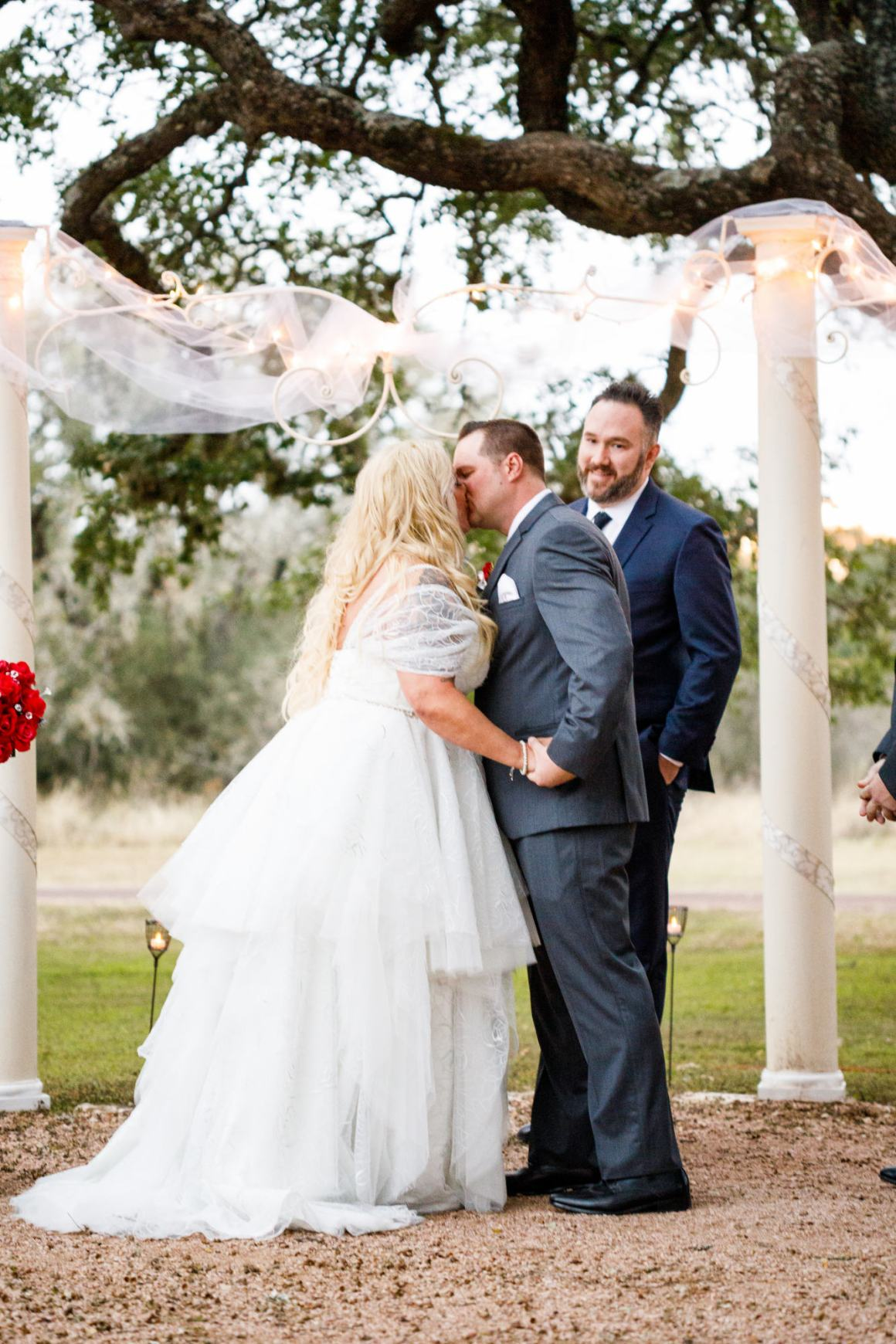 Bride and groom have their first kiss during their Buda wedding at Ruby Ranch Lodge near Austin, TX.