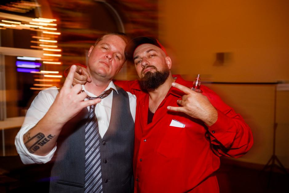 The groom and one of his buddies at their Ruby Ranch Lodge wedding reception in Buda, Texas.