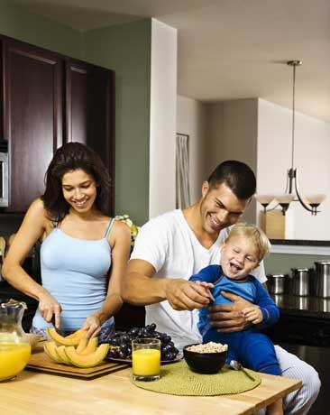 Family around Kitchen Appliances