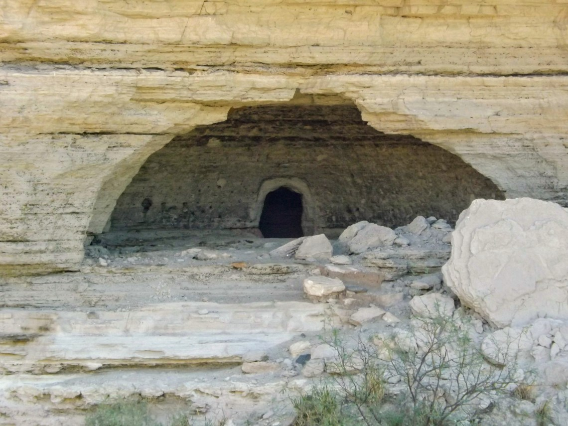 View of entrance to cave dug into canyon wall