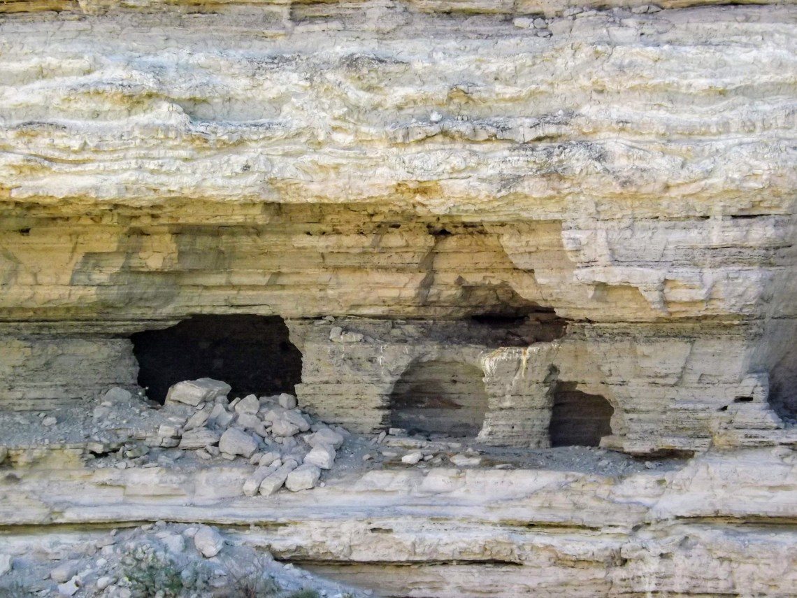 View of cave with entrance partially blocked by rubble