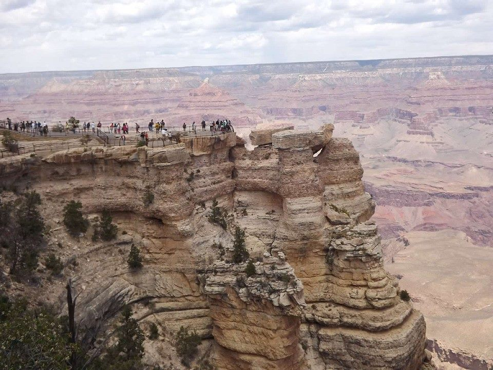 People gathered to look at Grand Canyon from viewpoint