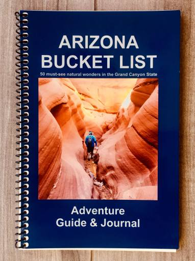 Image of blue book with white text and visual of man hiking in a slot canyon