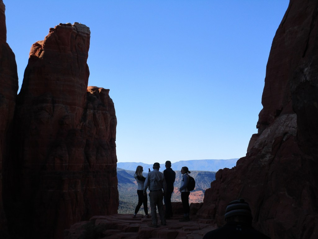 People posing for pics atop Sedona's Cathedral Rock Trail