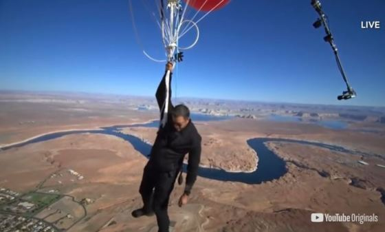 Lake Powell is visible in the background as David Blaine floats over Page, AZ