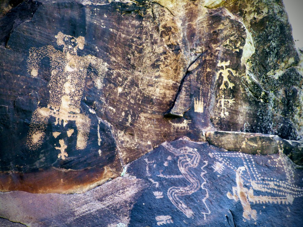 Birthing scene petroglyph at Rock Art Ranch