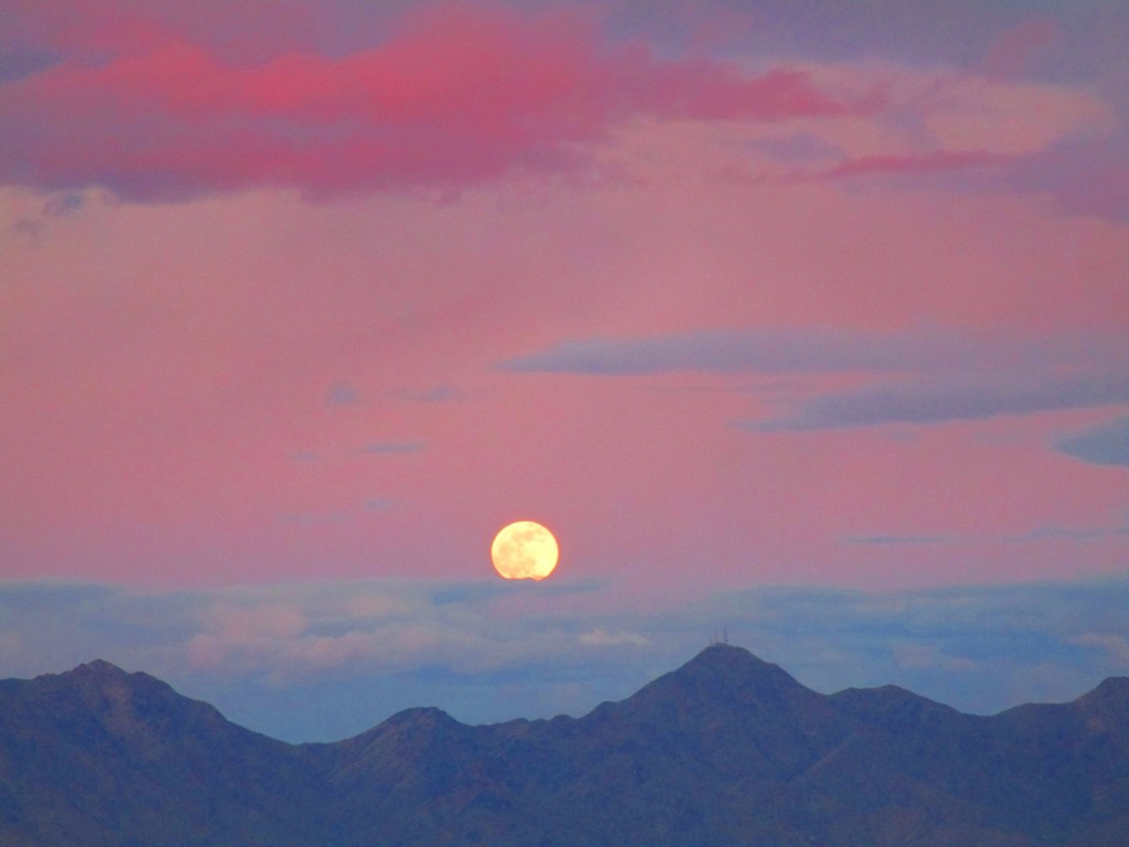 Full moon rising over mountains
