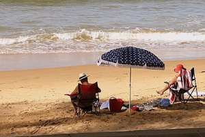 Relaxing at Shelly Beach. By Reginald J. Dunkley