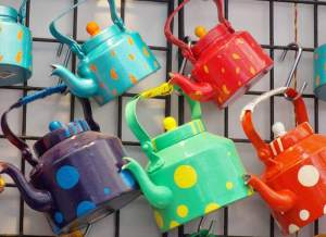 Colourful kettles for sale.