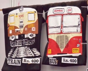Graphics of Mumbai's local train & bus transport on t-shirts.