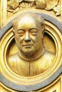 Lorenzo Ghiberti's self-portrait bust standing out from his own architectural masterpiece. Photo edit: Aditya Chichkar.