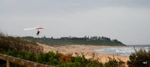 Hang-glider over Shelly Beach. Taken by Reginald J. Dunkley