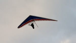 SHELLY BEACH HANG GLIDER IN THE AIR