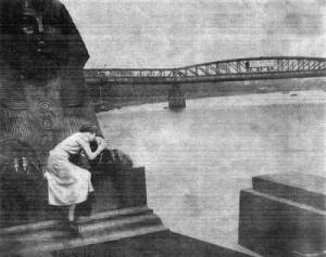Waterloo Bridge in July 1937, as seen from Cleopatra's Needle and complete with contemplative young lady (The floating pier can just be seen under the arch on the left).