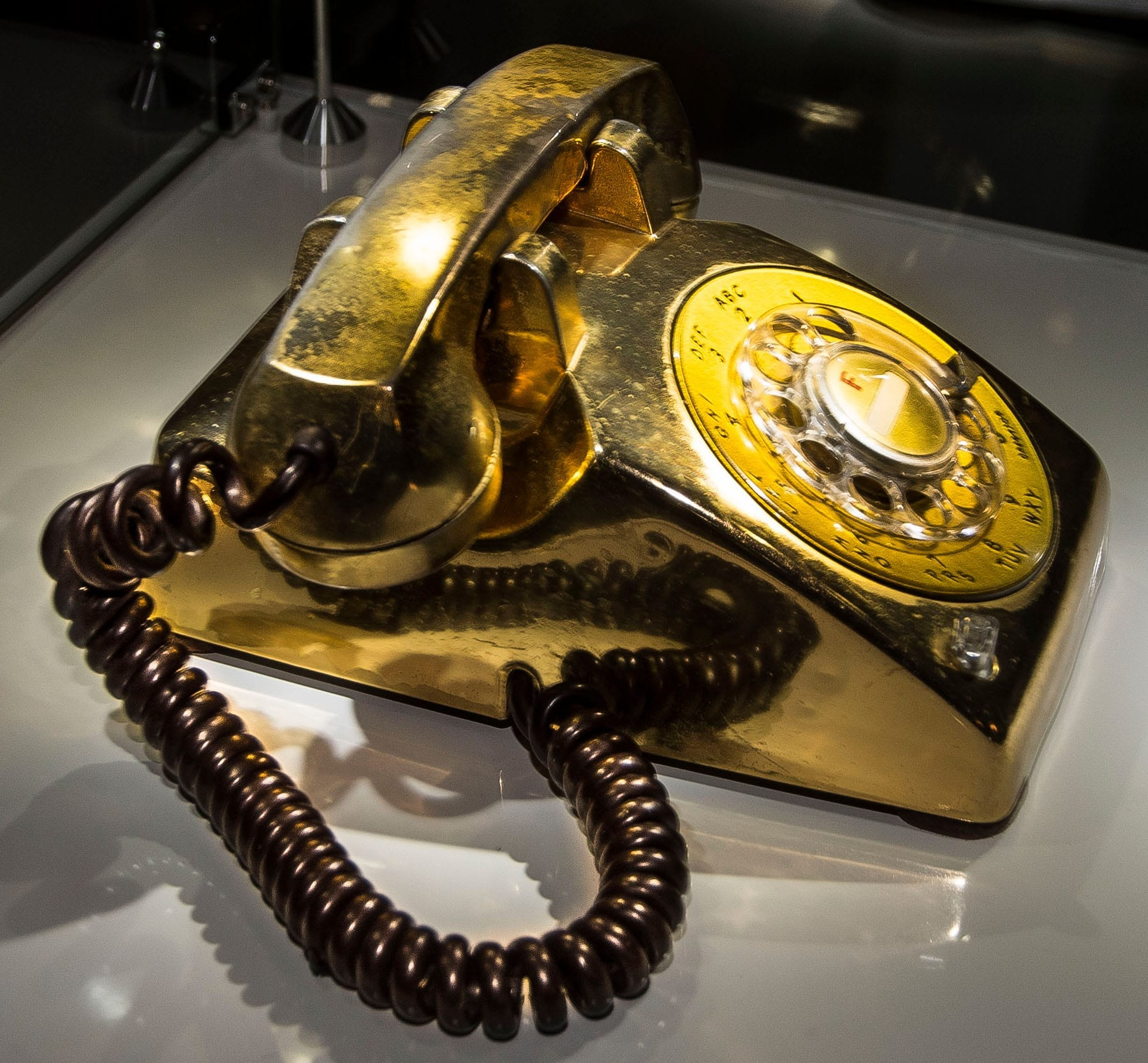 Gold telephone by beside Elvis's bed