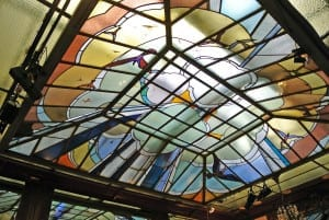 The stained glass ceiling of the Café du Palais, Reims