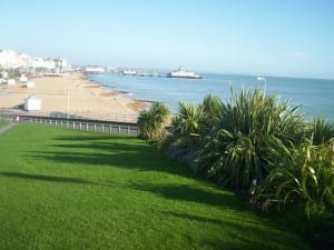 Taken from the Wish Tower slopes, with the Bandstand in the foreground, the pier, and Hastings the smudge on the horizon