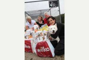 From Left - Sue Potter, Ami Grimes and Diane Cummings of Wilko, with Laura of Witherley Boarding Kennels, and happy pooch Willow.