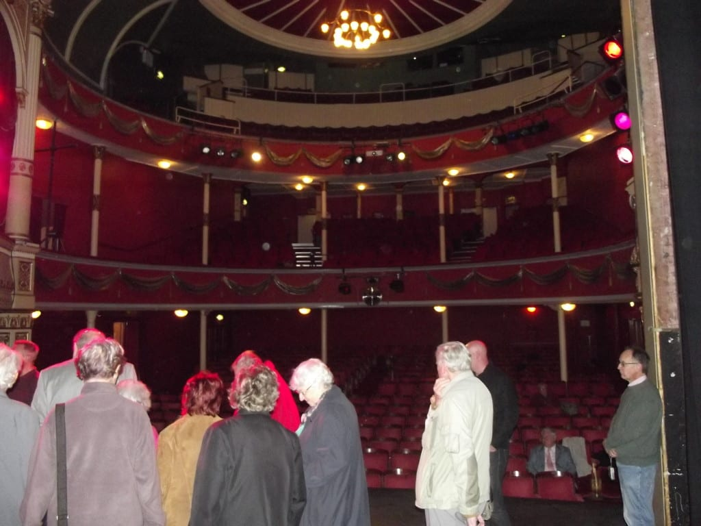 some visitors on stage during a guided walk around the theatre