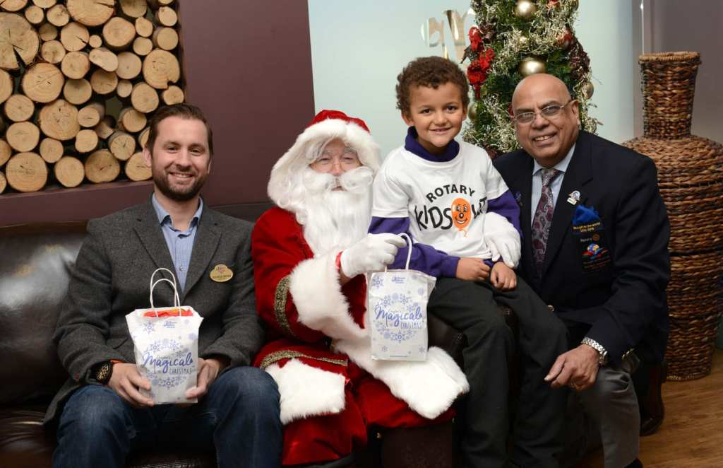 George Bryan, Director at Drayton Manor Theme Park, Devanti Palmer and Paul Jaspal from Rotary meet Father Christmas_smaller