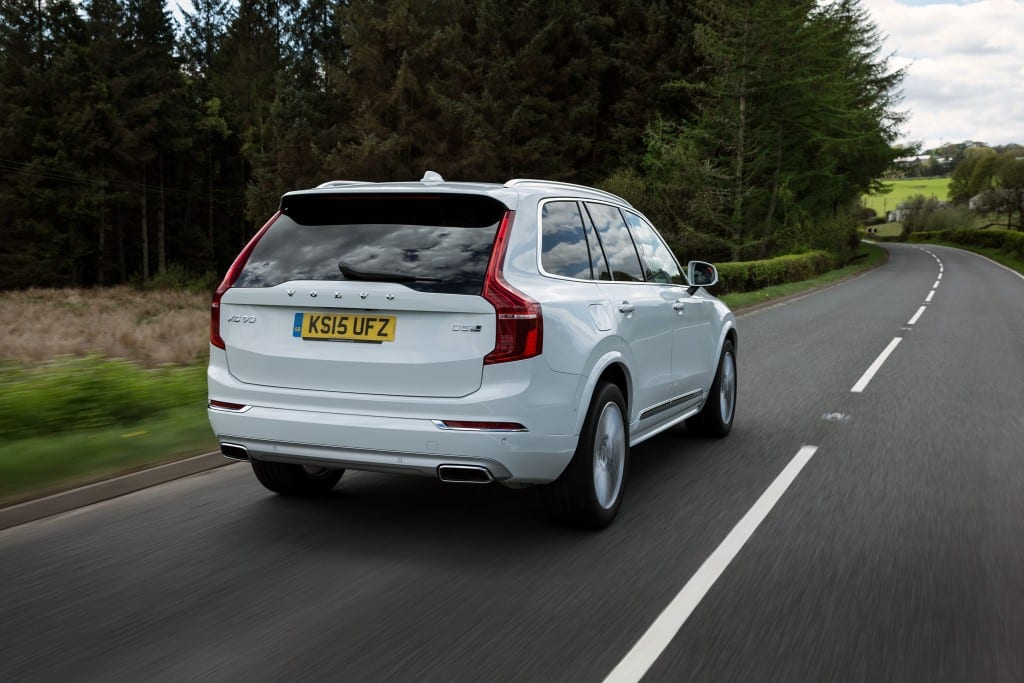 Rear, dynamic image of the all-new Volvo XC90 in Ice White