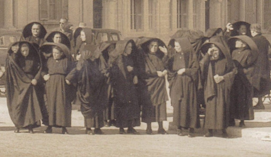 Women wearing the traditional ghonella in Gozo circa 1950.