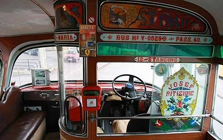 A driver's decorated cabin in the old bone-shakers.