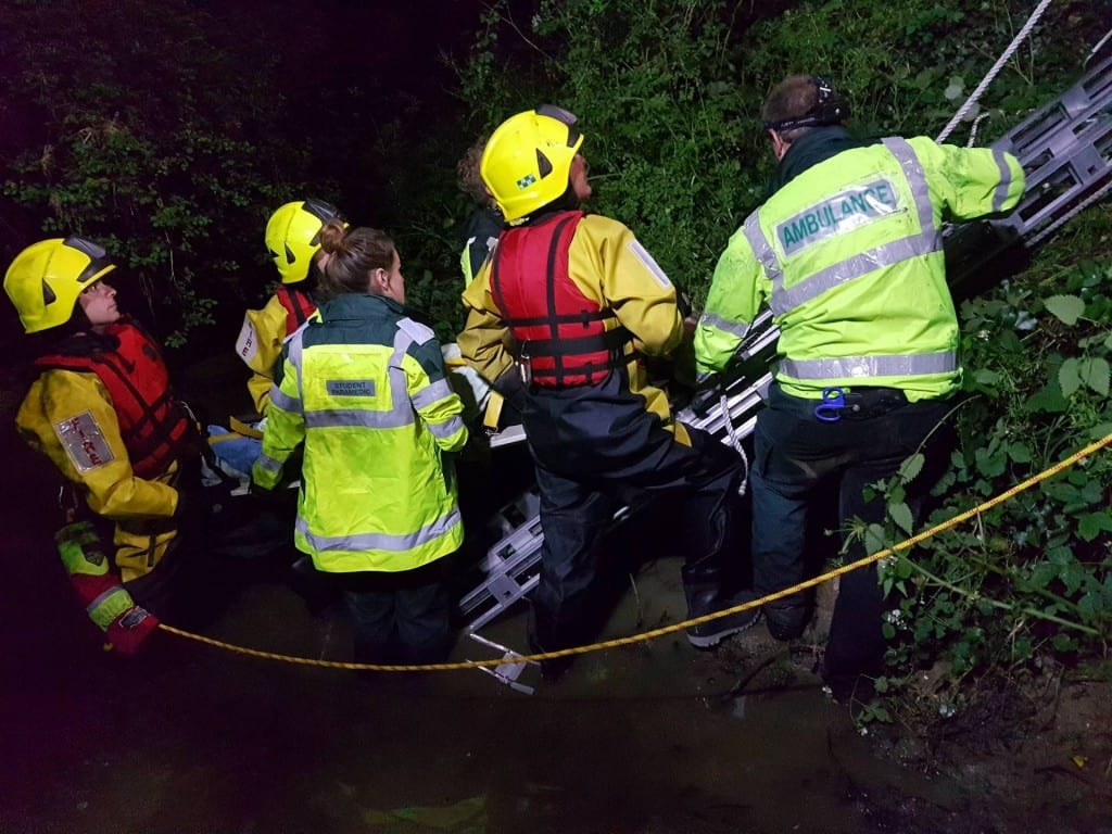 Fire and Ambulance crews lift Trevor out of the water