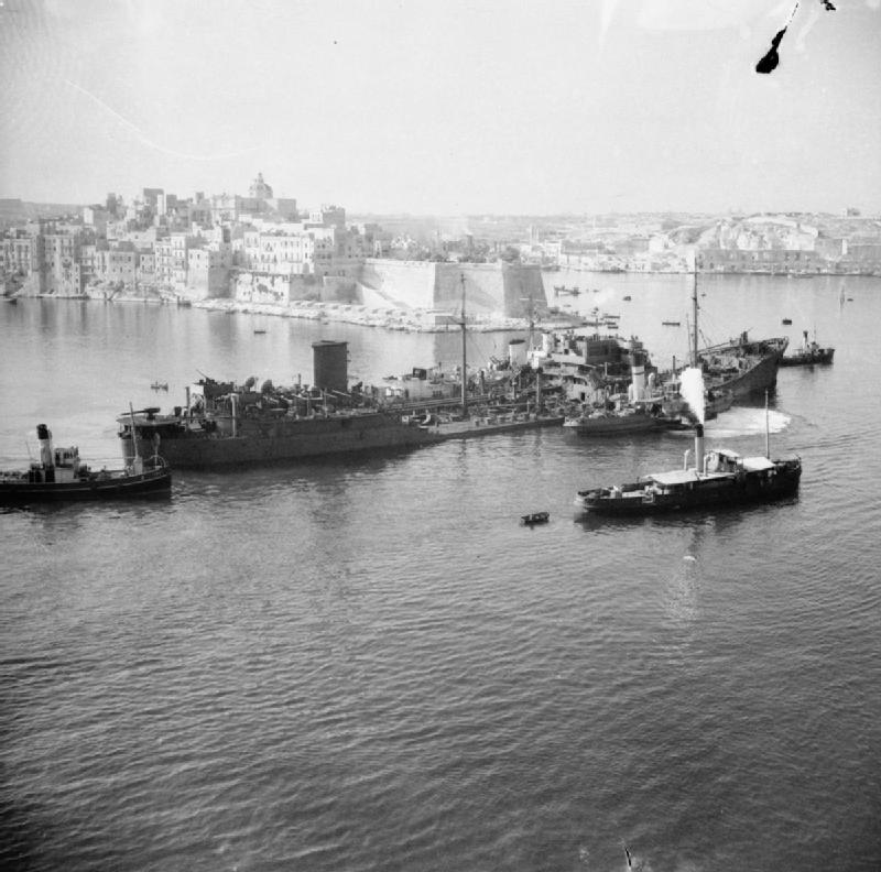 -the-ss-ohio-supported-and-limping-into-harbour-on-15-08-1942