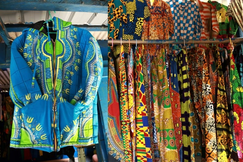 Line of lose trousers on the rail shirts behind a vibrant hoodie Cape Coast