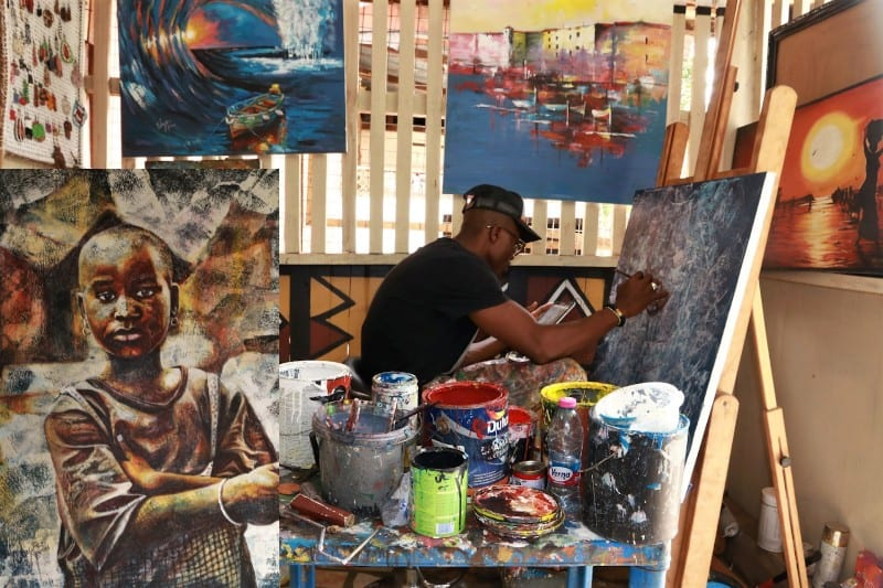 Nambu Kofi Evans in his studio girl in a pensive mood Kumasi