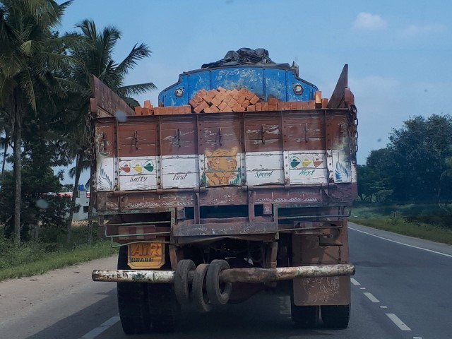 Safty First' – 'Speed Next' – The driver says with bricks unstacked and one step away from tumbling off the truck…