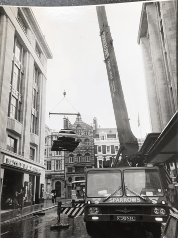 Audi and quattro hoisted above Kensignton streets